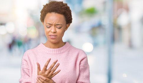 Women holding wrist in pain